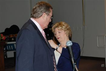 First Lady Beth Saunders pinning her husband Kentucky State President Vernon(Skip) Saunders.