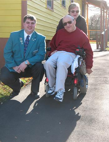 Larry and Marjorie Rice with Exalted Ruler Rich Taylor, on the repaved Driveway at the Rice's Partridge St. Home. The Members of Elmira Lodge #62 provided to have the age damaged driveway repaved, for this fellow member with Cerebral Palsy. Photo taken November 2009 by Mike Royle.