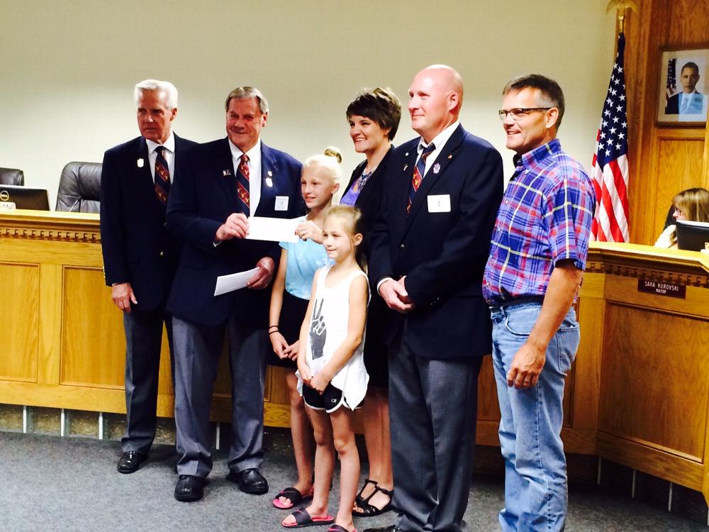 Officers formally present the $2,000 ENF Beacon Grant to the city of Pleasant Hill.