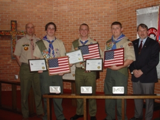 Exalted Ruler Greg Planting Giving eagle scouts certificate and flag from Elks lodge #133