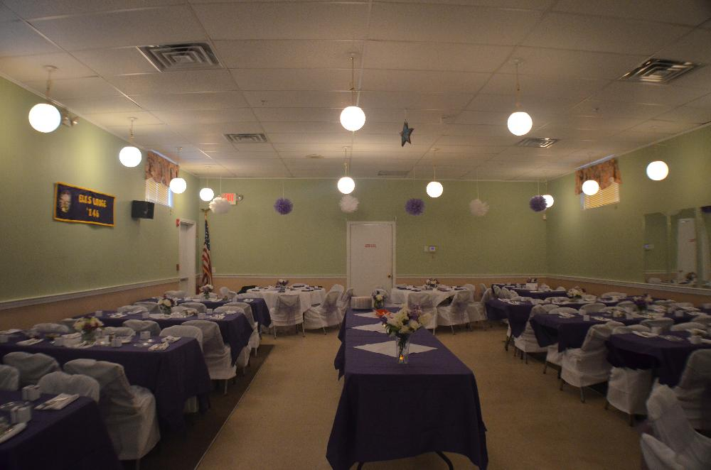 Hall decorated showing the tablecloths and chair covers available for rent for your event.