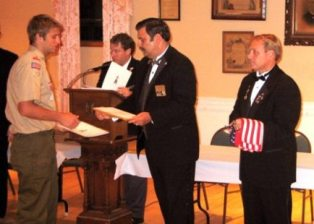 Taunton Lodge #150 Host Eagle Scout Court of Honor    On May 28, 2009, the Taunton Lodge of Elks #150 hosted a reception for the most recent Eagle Scout Court of Honor.  In all 16 young men received Scouting's highest honor, the rank of Eagle Scout.  The lodge welcomed local Scout Leaders, Eagle Scouts and their families, and as part of the evenings festivities, Lee Davis, Exalted of the Taunton Lodge of Elks and James Strojny President-Elect of the Massachusetts Elks Association, presented each Eagle Scout with a special certificate along with an American Flag, in recognition of their hard work and dedication in becoming Eagle Scouts.   Thanks also goes out to members Coz and Dom Magazu for putting on the meal for everyone back at the lodge.  Those receiving the rank of Eagle Scout were: Jonathan M. Bevis Troop 12, Dean G. Kennedy Troop 15, Jakob A. Carlson Troop 15, Robert C. Champagne Troop 15, Brian R.A. Riley Troop 17, Anthony E. Barbato Troop 20, Bernard Cross Troop 23, Ryan D. Crumbake Troop 26, Nathan F. Thomas Troop 26, Kyle A. Aptt Troop 33, Ryan P. Friedlander Troop 35, Clayton P. King Troop 40, Sean P. Mahoney Troop 48, Daniel R. Somerville Troop 48, Zachariah S. Cobb Troop 61 and Cameron J. Parker Troop 61.   Pictured below L-R Eagle Scout Bernard Cross being presented with his Certificate from MA Elks President-Elect James Strojny and an Americian Flag from Taunton Lodge Exalted Ruler Lee Davis.