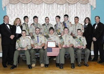 On May 1, 2008, the Taunton Lodge of Elks #150 hosted a reception for the most recent Eagle Scout Court of Honor.  In all 14 young men received Scouting's highest honor, the rank of Eagle Scout.  The lodge welcomed local Scout Leaders, Eagle Scouts and their families, and as part of the evenings festivities, Lee Davis, Exalted Ruler of the Taunton Lodge of Elks, presented each Eagle Scout with a special certificate along with an American Flag, in recognition of their hard work and dedication in becoming Eagle Scouts.   Those receiving the rank of Eagle Scout were: Derek U. Terrio Troop 20, Nigel E. Krofta Troop 25, Michael A. Archambault Troop 37, Michael J. Perry, Jr. Troop 40, Joseph P. Wieczorek Troop 40, Ethan A. Beise Troop 51, Daniel C. Dalton Troop 51, Matthew C. McCue Troop 51, Jay Patrick Thornton Troop 51, Michael A. Fiore Troop 61, Mark A. Ledbetter Troop 61, Eric R. Marsan Troop 61, Johnathan T. Lavelle Troop 79 and Michael P. DiBenedetto Troop 79.  Pictured Above (L-R) with 11 Eagle Scouts with their certificates and American Flags, are Taunton Lodge of Elks #150 Officers Matt Pittman Loyal Knight, Linda Downing Lecturing Knight, Sherry Rose Secretary and Lee Davis Exalted Ruler.