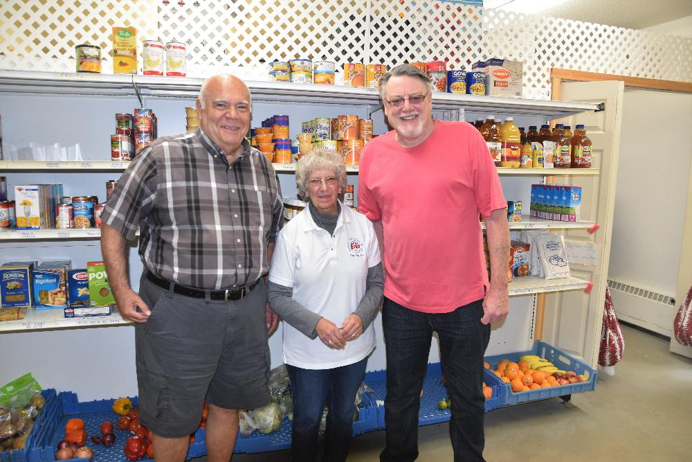 Ben, Marge and Peter at the Wilton Food Pantry getting ready to pack bags of food!