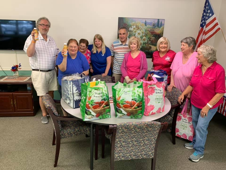 Senior Outreach Committee Delivering bags of food to Seniors - Impact Grant