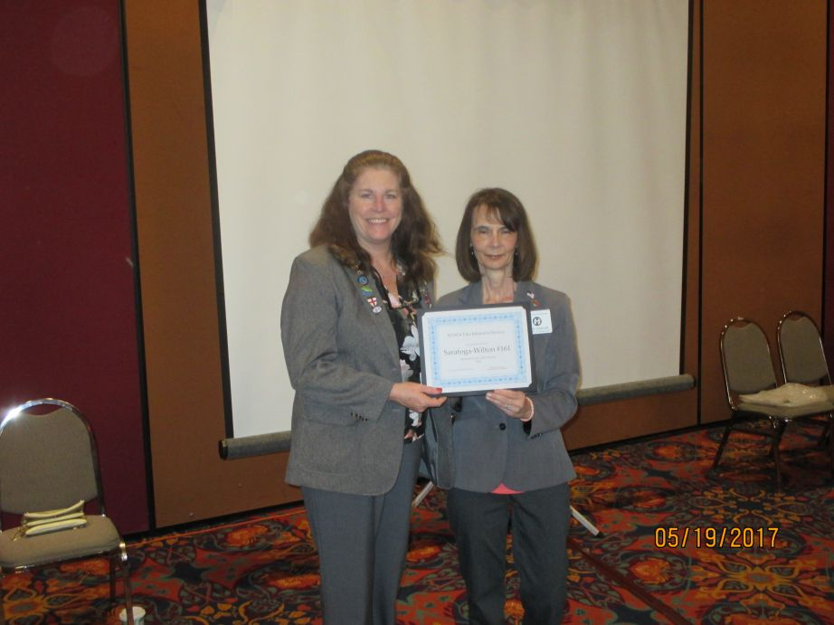 ER Deborah McCabe accepting the 2nd Place Award for the Memorial Brochure at the Spring NY State Convention.