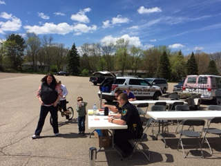 Oak Park Heights Officers providing safety information at Stillwater Elks May 1st Bicycle Saftey and Tune-up Event.