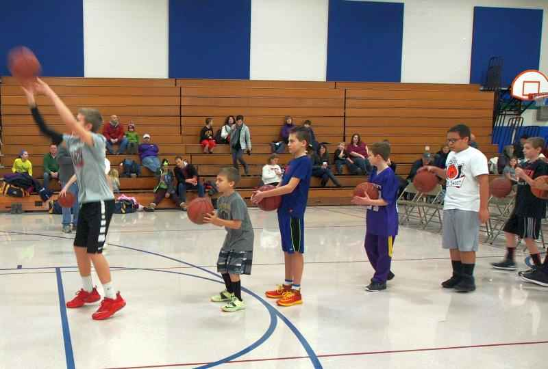 Boys warming up the Youth Hoop Shoot Event