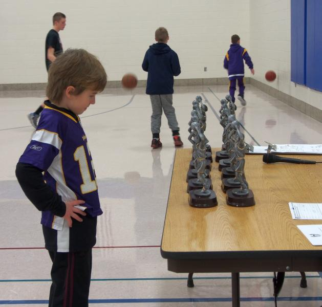 Checking out the boys and girls trophies awarded at the Stillwater Youth Hoop Shoot Event.