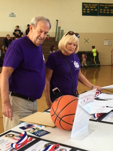 2017 Hoop Shoot - Barb & Phil Shepp reviewing the results