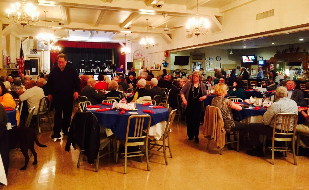 Social hall full of Veterans and their guests.