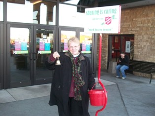 Exalted Ruler, Alice Wolf takes time from her volunteer shift to pose for a picture.  On Friday December 4th Elks volunteered for one hour shifts at the Salvation Army Kettle in front of Kennedy Mall.