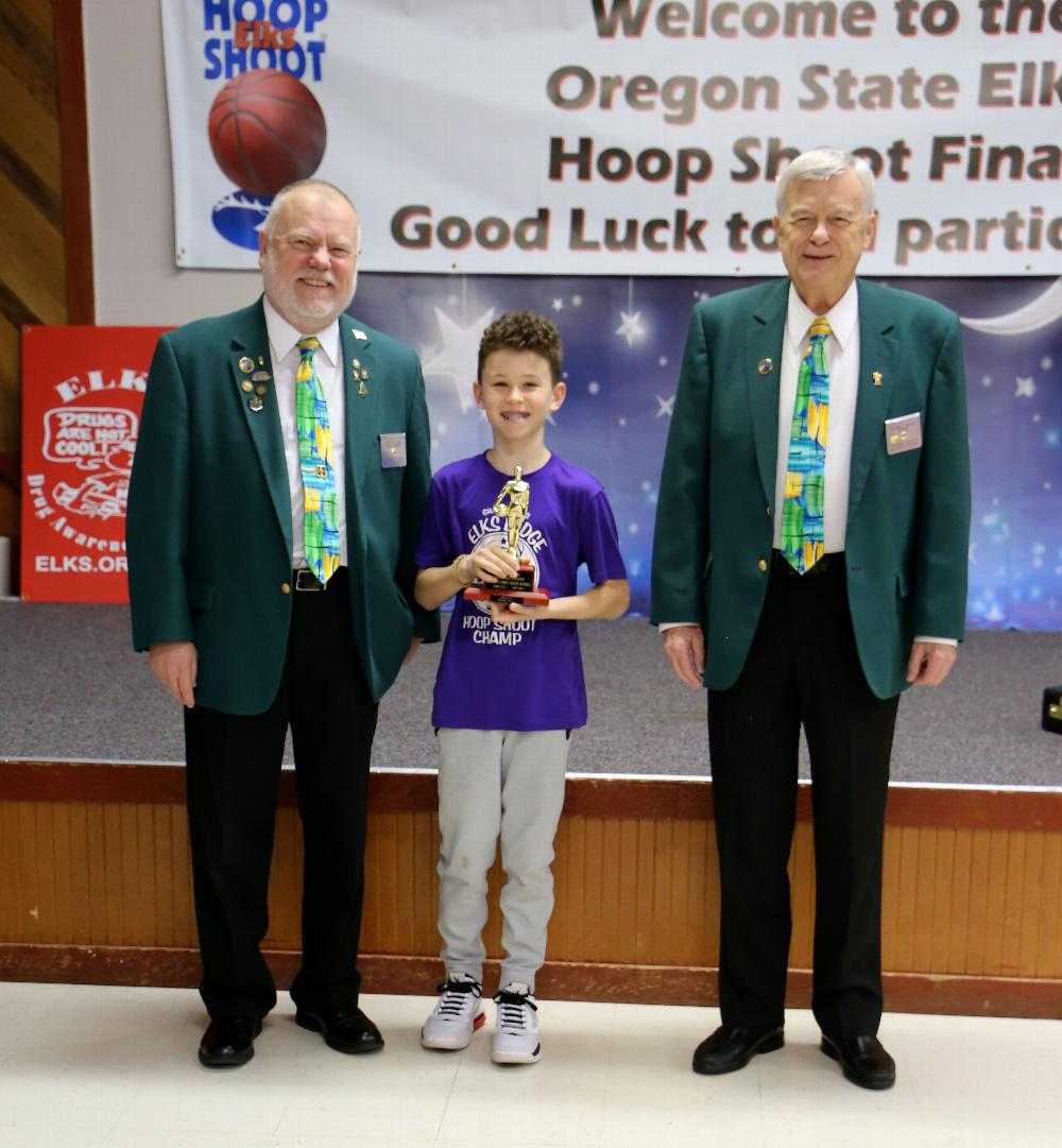 OSEA Hoopshoot Contest<br> Front row: OSEA President Carl Lino, Kaylee Strain, SW District VP Herm Blum, & SW District Hoopshoot chairman Joel Buoy<br> Background: OSEA Hoopshoot Chairman Skip Caldwell