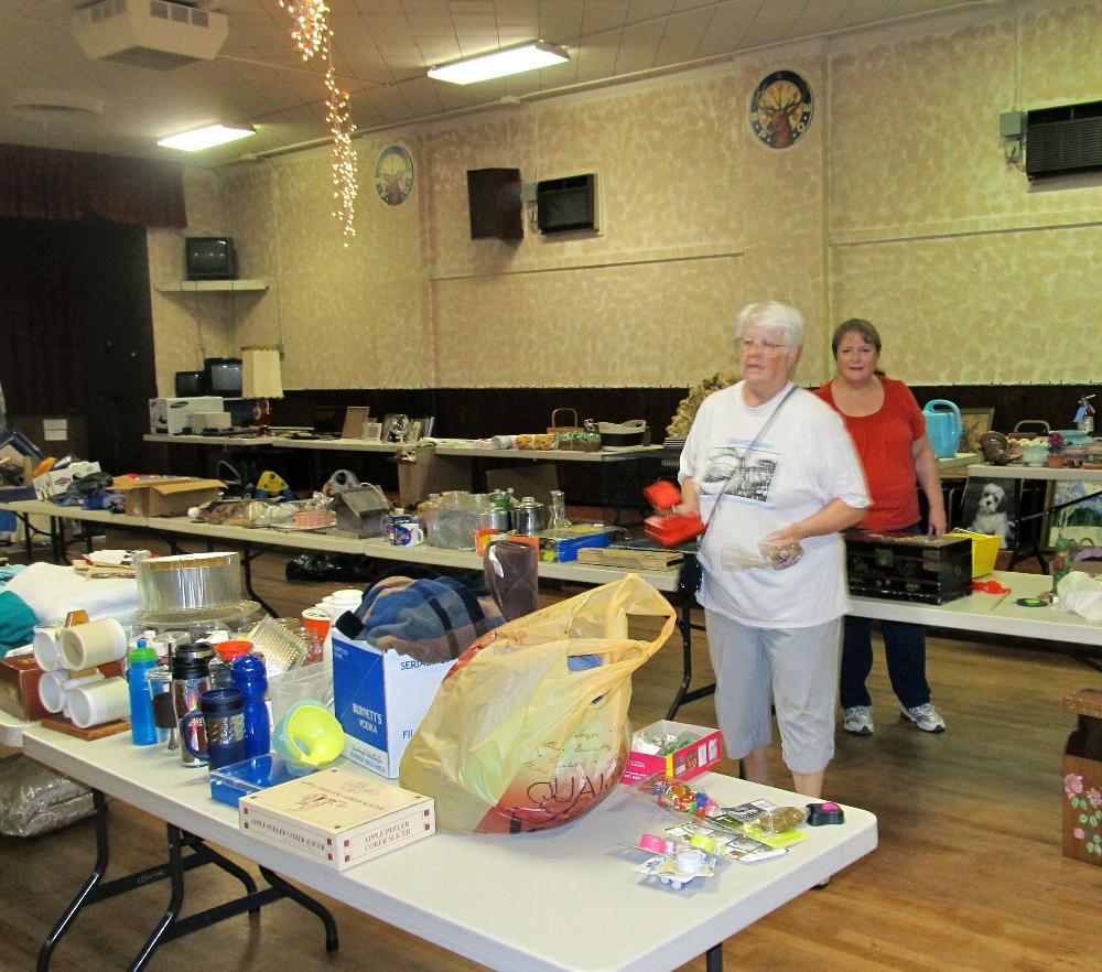 Cheryl Lumley & Joy Malone working on Elkette rummage sale