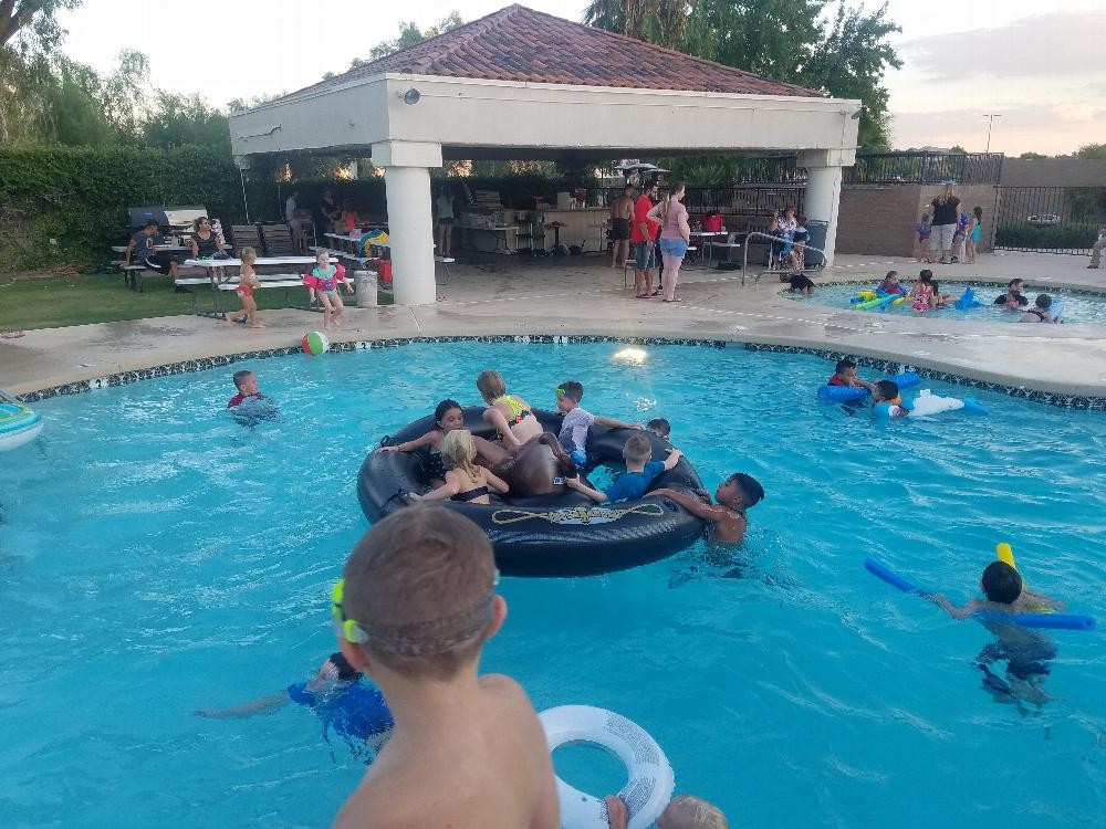 Kids enjoying the pool before the movie starts