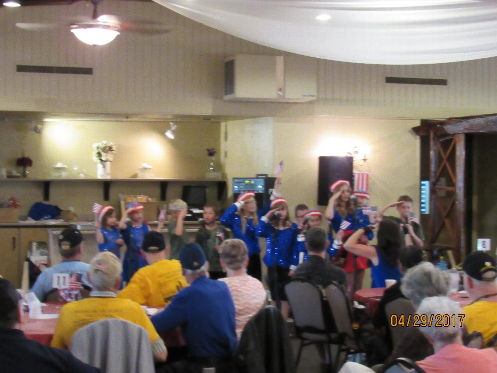 Some young Americans paying tribute to some WWII veterans at our Honor Flight Reunion luncheon.