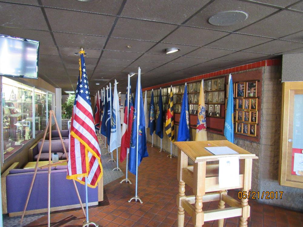 The front of our Lodge with the American Flag, all the state flags and the military flags set up.