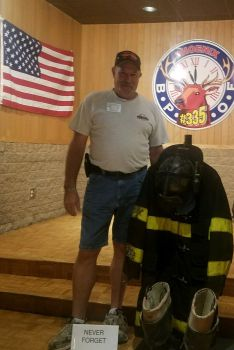 Lecturing Knight Randy Sterling a retired firefighter set up a memorial on 9/11 to remember all those who lost their life's on 9/11/ 2001. Not pictured was the flag that Randy displayed made with the names of all who died that day 16 years ago.