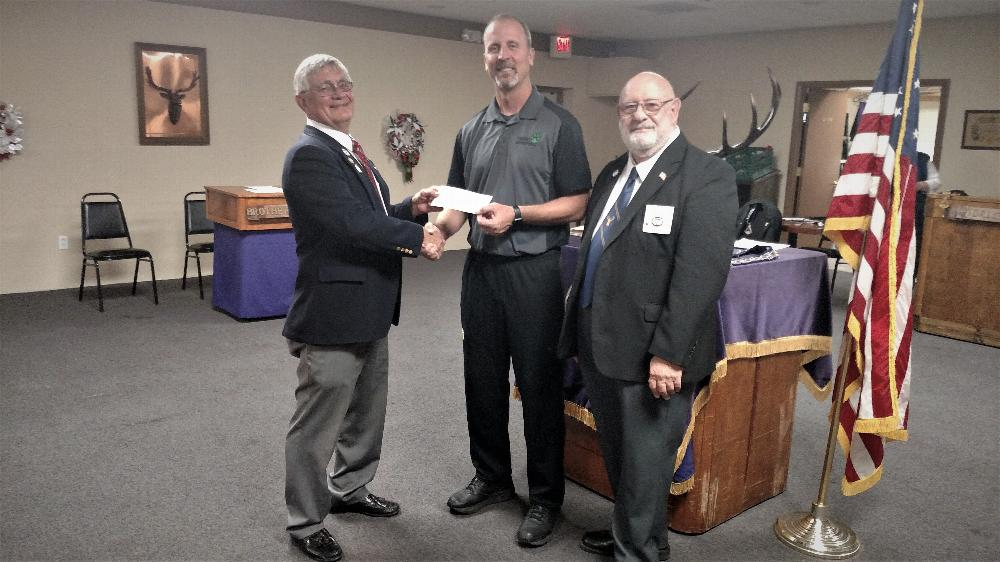 Tucson Amphi High School Coach Ben Hurley receiving $1000.00 donation for youth program from Tucson Lodge ER Joe Jablonski and AEMP South District VP Ira Cohen