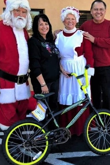 2018-Bike in a Box-Jesse and Carol Lugo-Lugo Charities with Santa and Mrs Claus.  Thank you Jesse and Carol for donating and once again making 500 kids happy this Christmas.