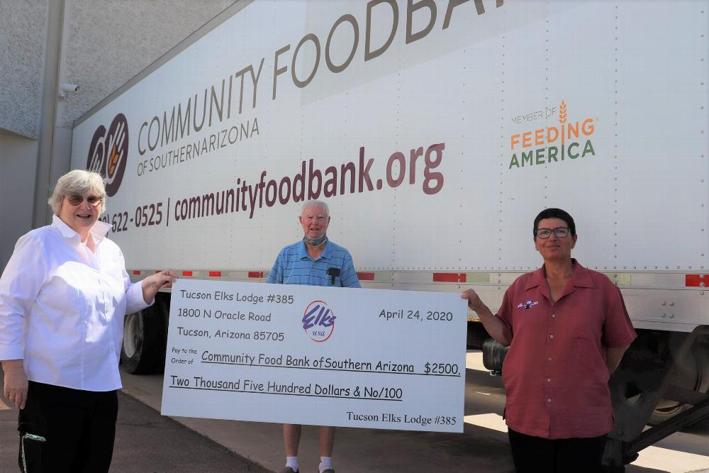 Tucson Elks Lodge 385 applied for and received a $2,500 Gratitude Grant from the National Elks Foundation and donated the monies help the Tucson Community Food Bank. Pictured April 24, 2020,  L-R, D. Gnuschke, B. Holyoak and ER M.Lopez