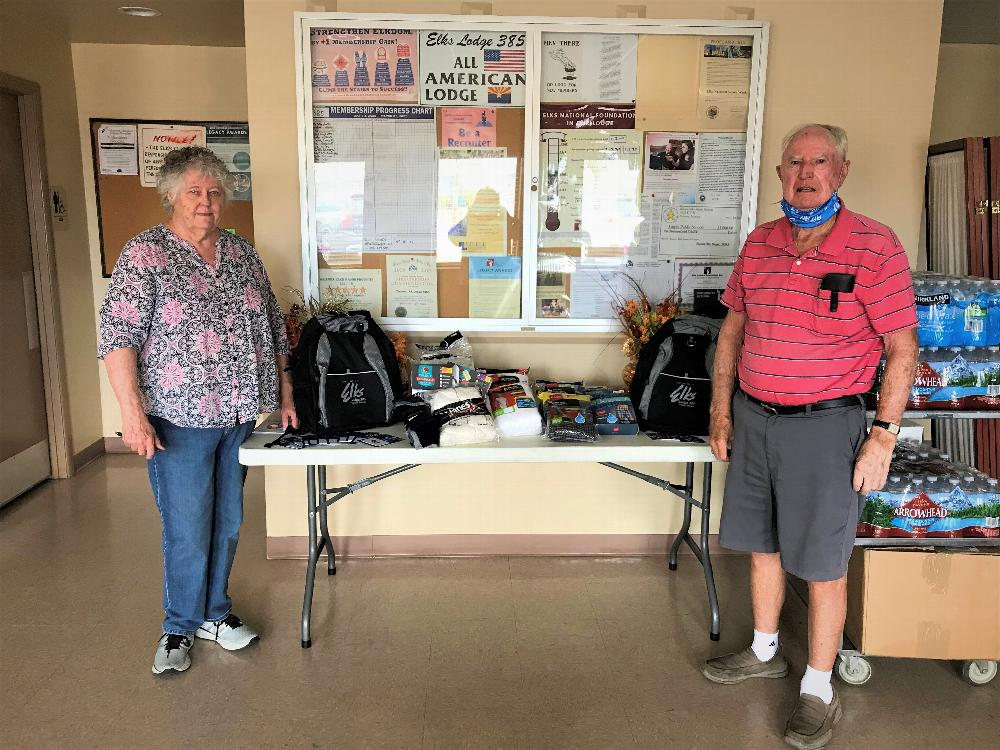 June 26th 2020, Tucson Elks Lodge #385 donated to the Veterans Homeless Program 25 backpacks, bottled water, socks and underwear, using Elks National Veterans Service Commission Freedom grant money and donations totaling $1083.00. Picture is Trustee/PER B. Holyoak and Lodge VA Co-Chair Teen Morgan.