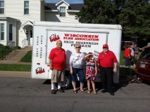 Elks Drug Awareness trailer that was in 2016 Memorial Day parade.  Pictured are George Myer (State President-Elect at time), Murial Myer, and guests from Rice Lake.