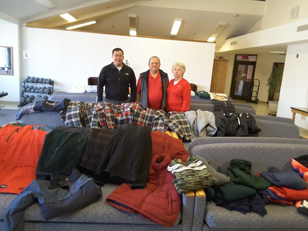 George and Muriel with clothing contributions laid out for the residents to inspect and select.
