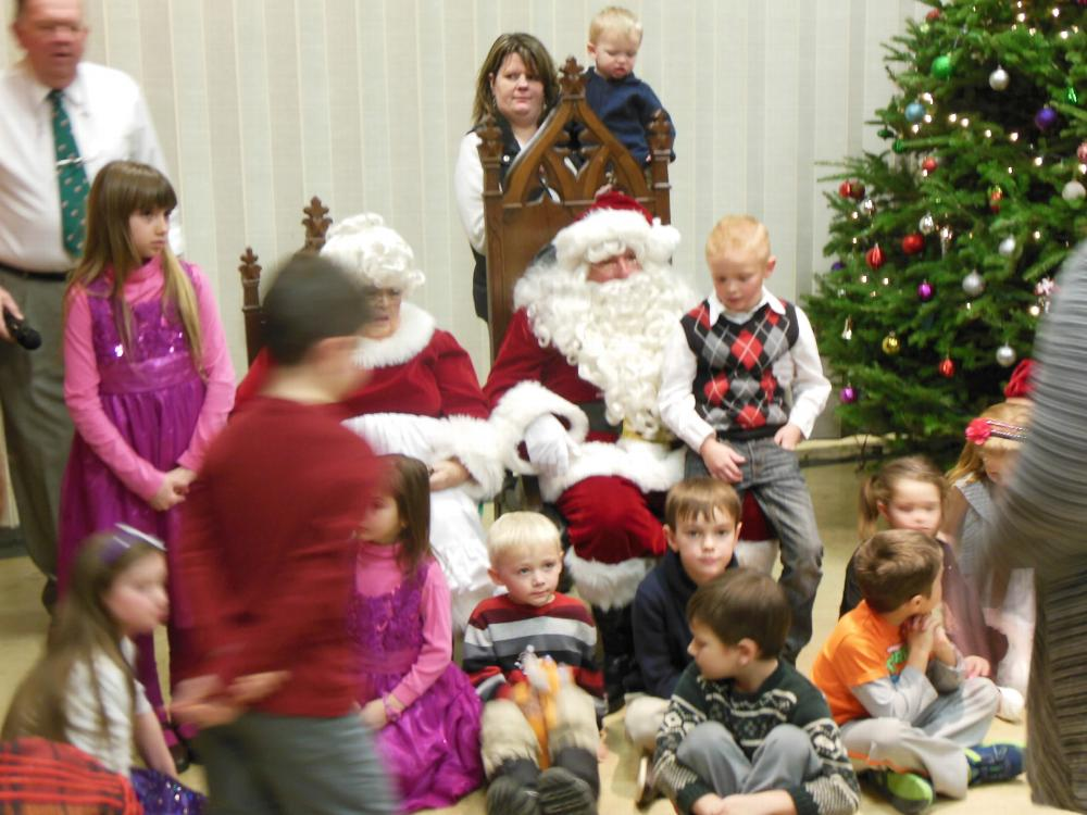 Santa and his helper visit the Bennington Lodge.