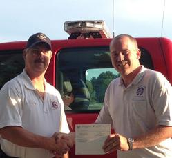 Cape Girardeau Elks Lodge No. 639 donated $2,000 to help the Missouri Children's Burn Camp at its annual Fourth of July celebration. At left is DeWayne Kirchhoff, chief of the East County Fire Department, and Jason Ledure, exalted ruler of the lodge.