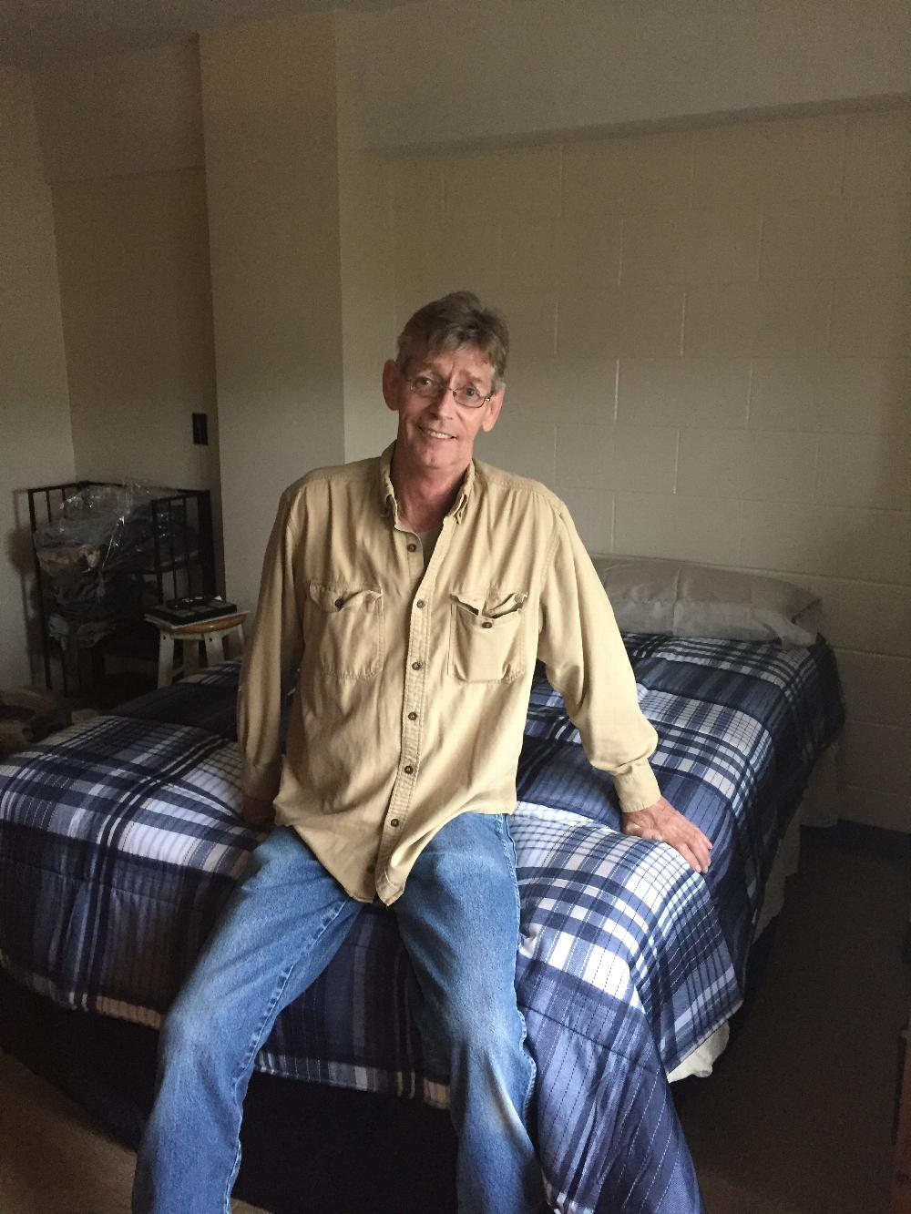 Army Veteran Alan Daigle of Woonsocket on his new bed donated by the Westerly Elks September 2017
