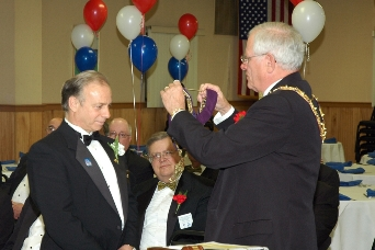 Exalted Ruler Michael Severns being installed by Barry Cole, DDGER.  Photo by Stephen Cersosimo