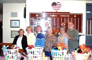 Thanksgiving baskets given to 12 area needy families.  Each of the 12 baskets contained a certificate for a Thanksgiving turkey.   Shown (Left to Right) Louise Smeraldo, Roberta Hublard PER, Kim Kraemer Activities Chairperson, Jeanette Cole Event Chairperson, and Louise and Ron Osborne.  Missing from Photo:  Joan Defanti