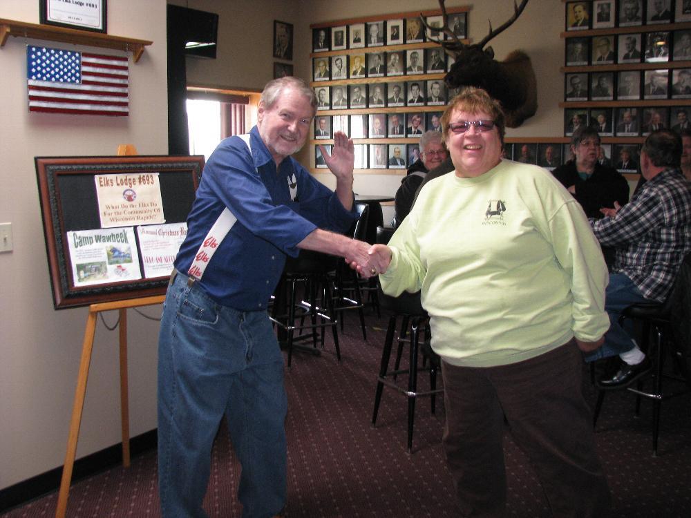 Paul Weimer greets a Lenten Fish Fry diner.