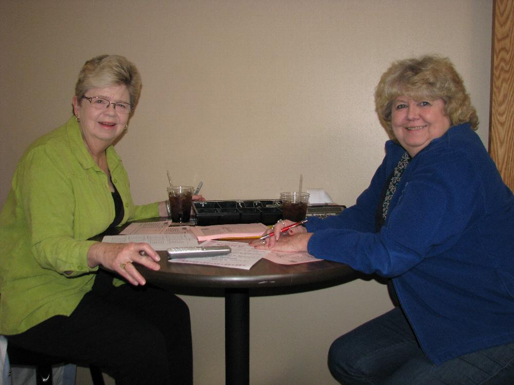 Elks Lady Sue Weimer and Lecturing Knight Diane Kramer take delivery orders.