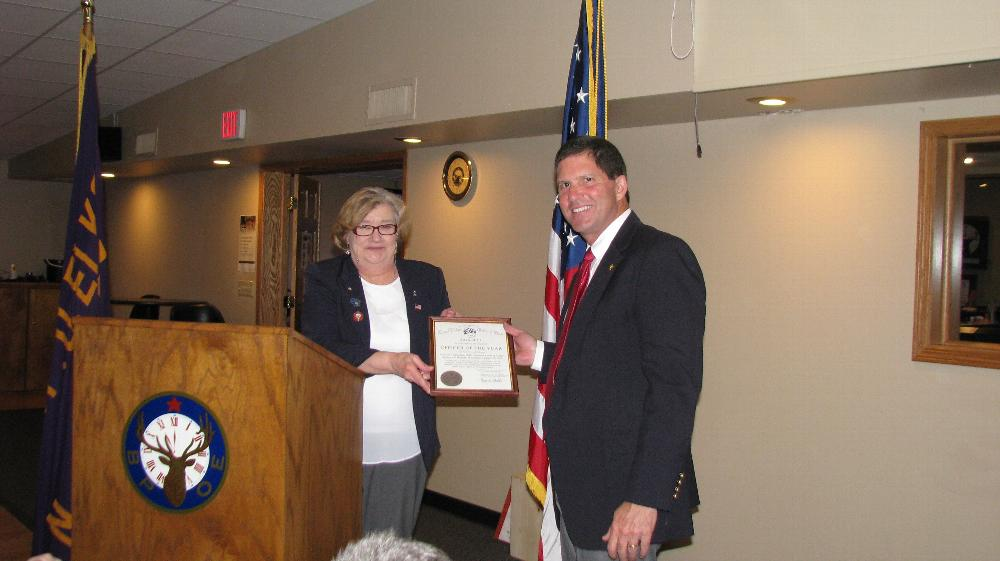 ER Marilyn Gillies presents Officer of the Year Award to Mike Spranger