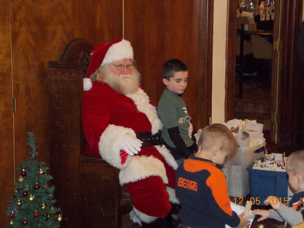 Lunch with Santa kids telling Santa what they want for Christmas!