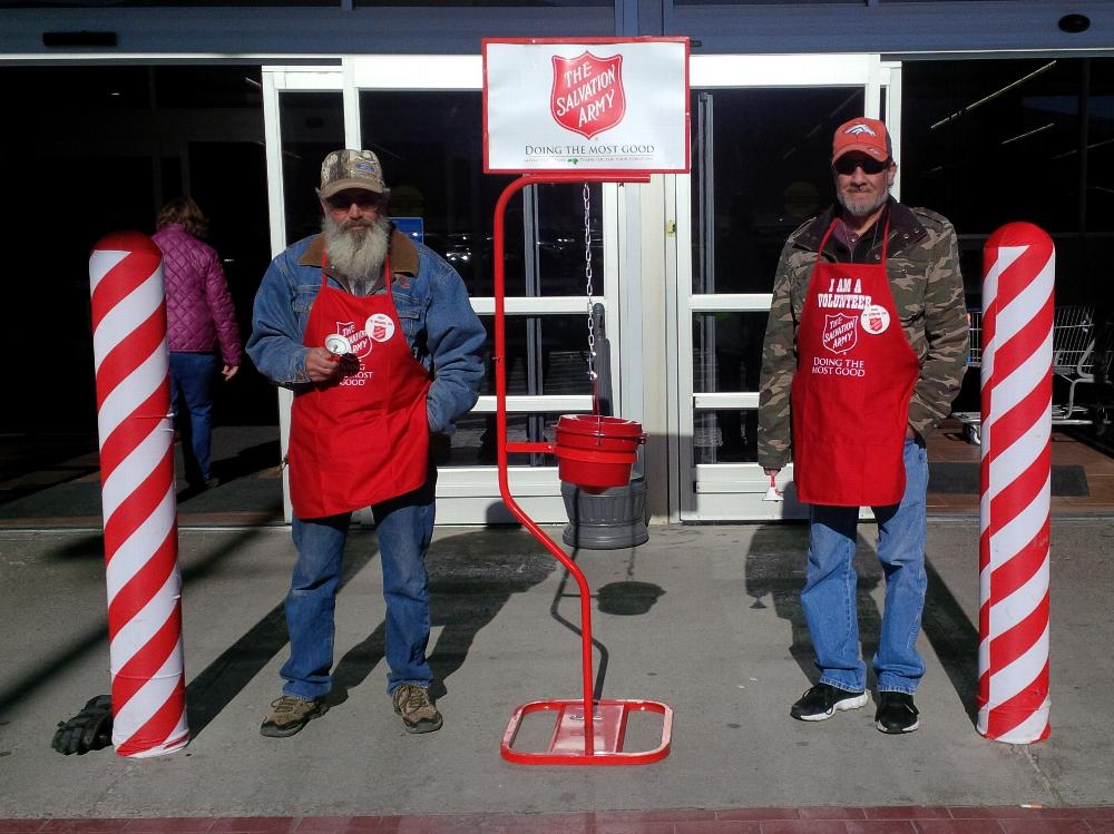 ER Jim and Inner Guard Chris ringing the bell for the Salvation Army