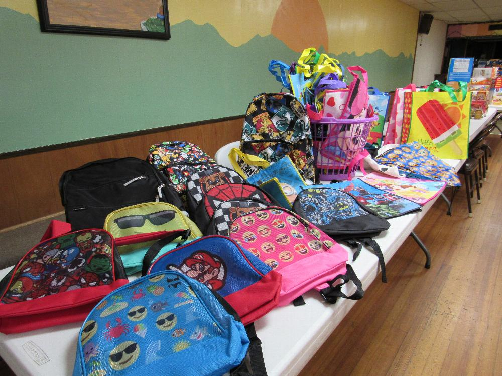 Some of the back packs and bags at the Lodge that will be filled with food for kids who need it during Spring Break - 2017-2018 Beacon Grant