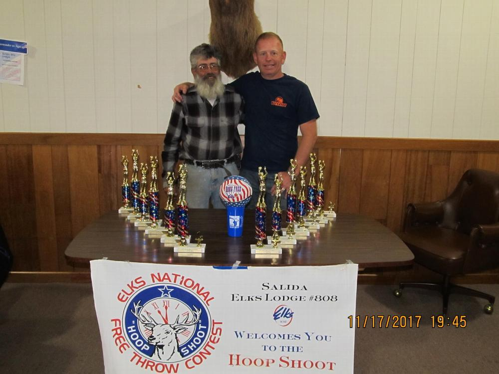 ER Jim DeLuca and State Hoop Shoot chair Brandon Wilkins with local shoot trophies