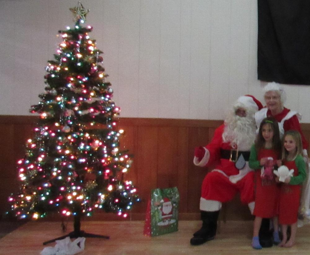 Santa Claus Paul Nelson and Mrs Claus JR Latimer at the annual Pajama Party