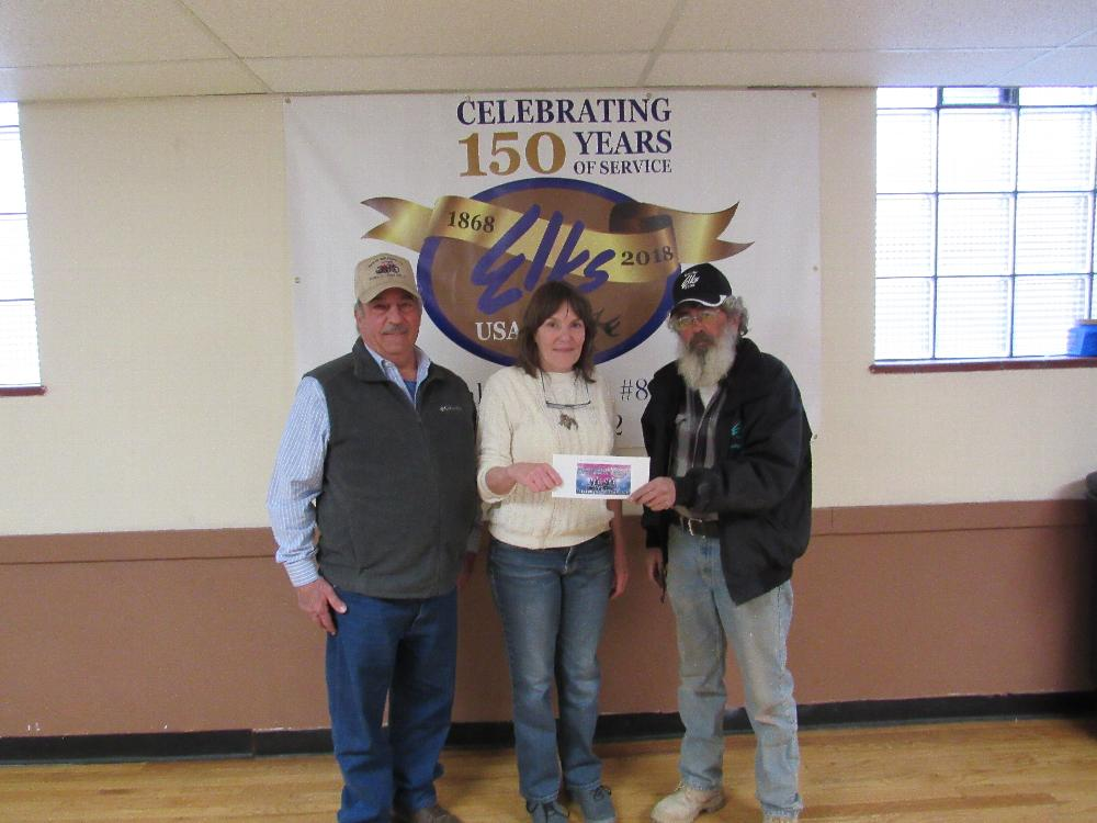 Colorado Farm to Table receiving their $150 check in celebration of the Elks 150th Anniversary