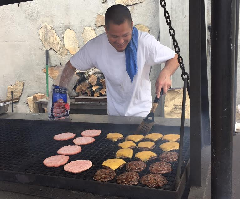 Evan Clark mastering the grill on Pool Prep Day  - May 2016
