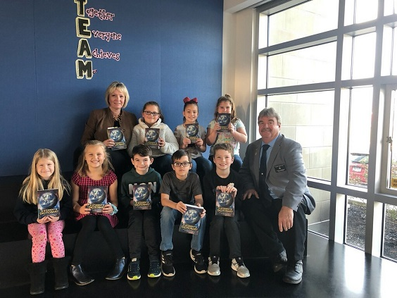 ER Steve Gregory and Suzanne Newswanger present dictionaries to students at the Owego Elementary School in support of the Elks Dictionary Project