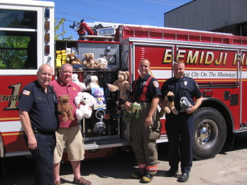 Leading Knight Candace West rounded up Teddy Bears from Bemidji Elk members during the July dinner. These bears were donated to the Bemidji Fire Dept. The bears are used to give to children during times of stress.