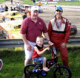 Candace West was able to have two bikes donated to give away at the Bemidji Speedway for Drug Awareness night. Pictured above are E.R. Ken Traxler, Driver Chad Wolff (who worked with the Elks) and bike winner Tyler Swann.