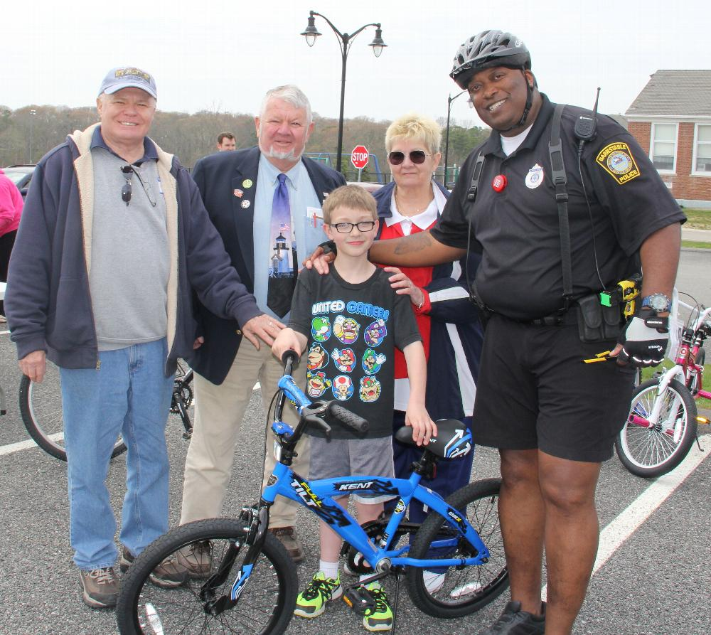 From L to R: ER Dave Dunbar, Trustee Dave Ganshaw,Treasurer Betty Legere, Officer Brian Morrison, Barnstable Police Department, with one of our lucky winners, Richard Hurley
