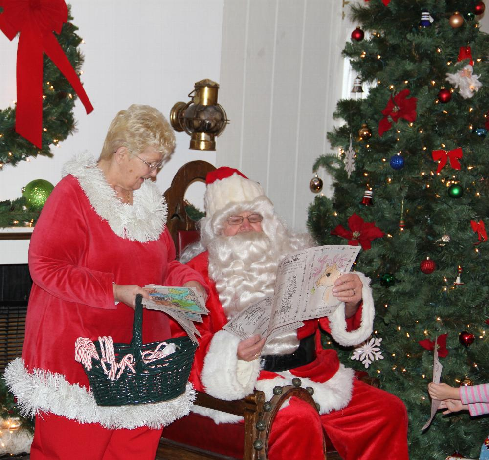 Santa and his helper Betty takes a look at all the wonderful coloring pages the kids gave him for Christmas!