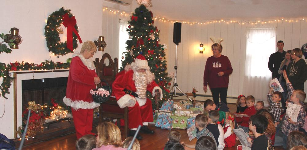 Santa prepares to give out gifts to the children!
