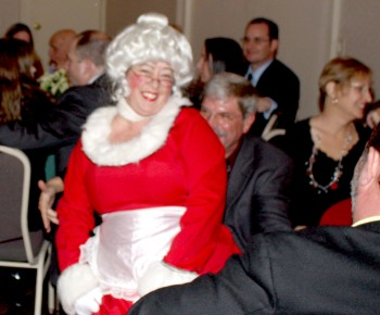 Mrs. Claus shows Mark Fisher that she's as friendly as Santa is!